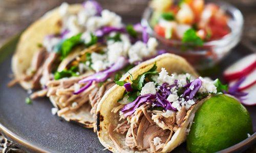 bigstock-Street-tacos--with-carnitas--225381346